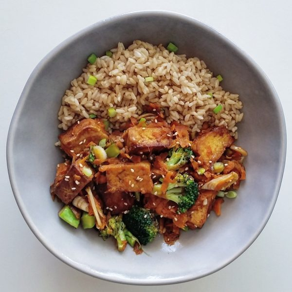 Crispy tofu stir fry with a glaze made from miso paste and agave nectar
